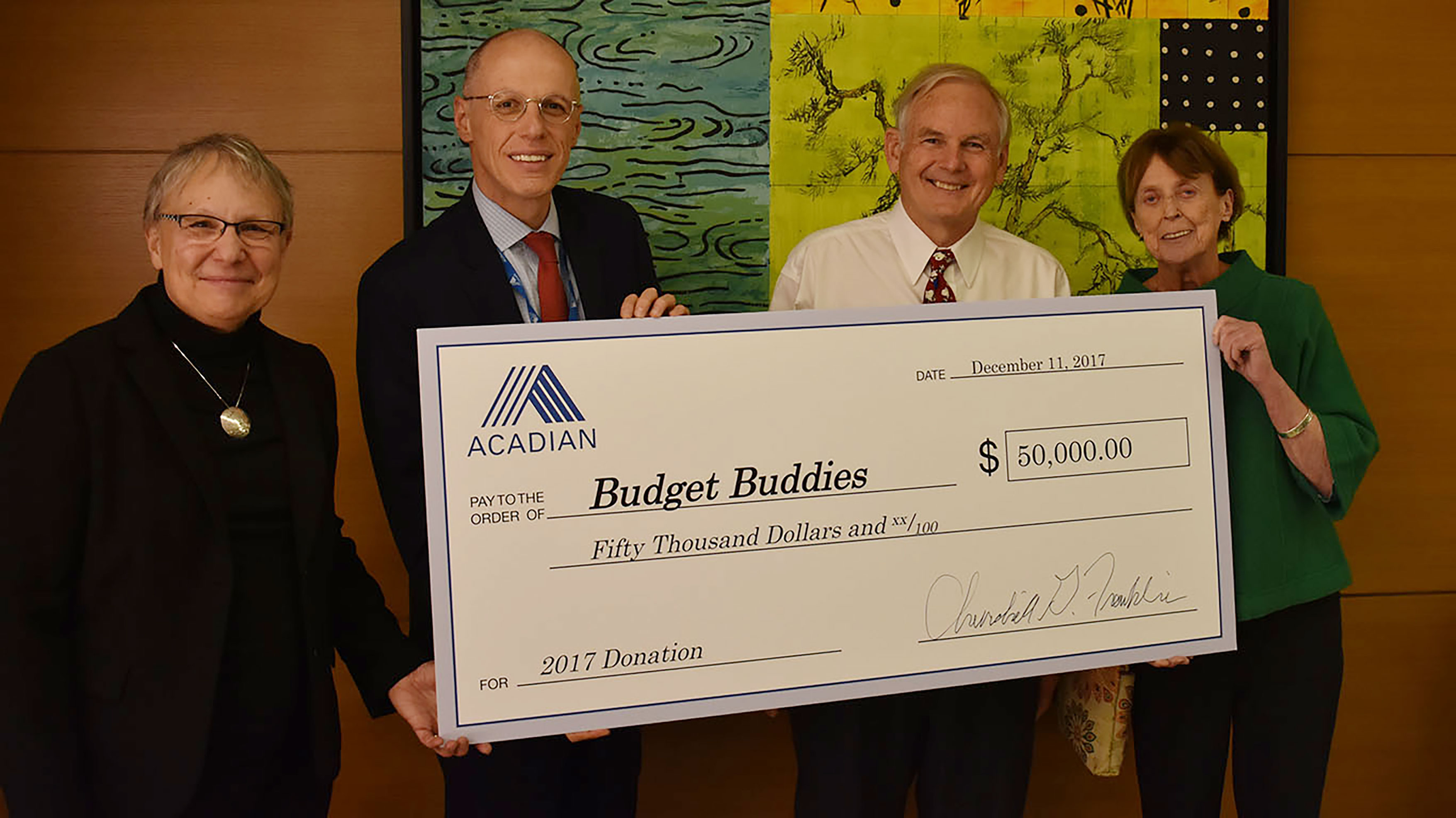 Acadian presenting donation to Budget Buddies
