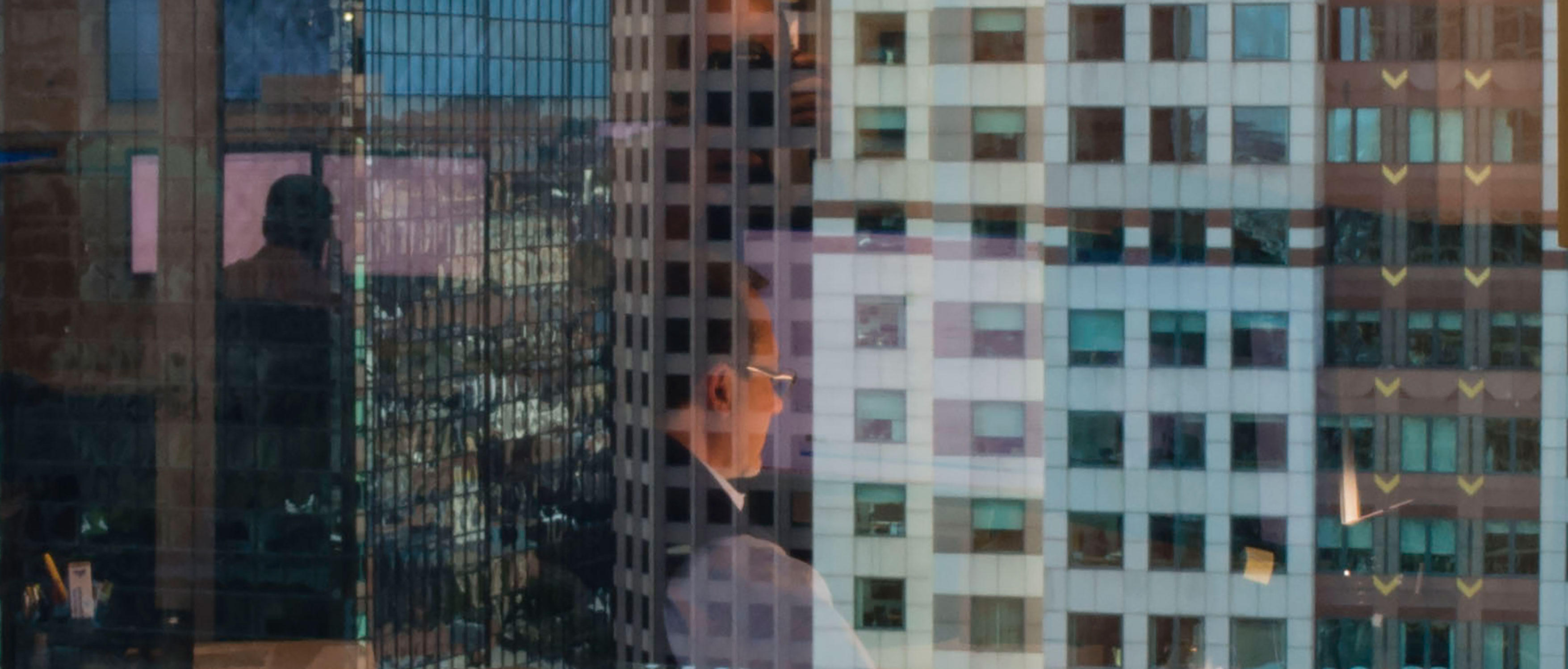 Cityscape with employee reflection in the window